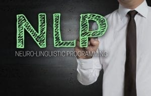 NLP is written by businessman on screen