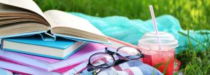 Books,,Glasses,And,Drink,On,Grass,Close-up