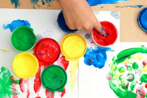 Children,Finger,And,Paints,On,A,Table.,Children,Playing,The